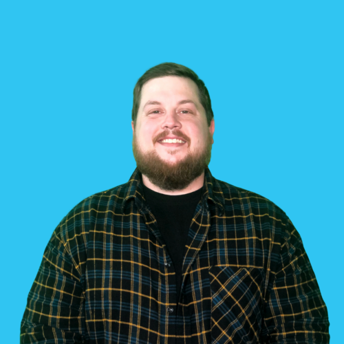 Alex McFarland portrait on blue background