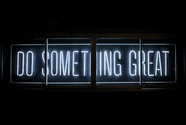 "Neon sign that says ""do something great"""